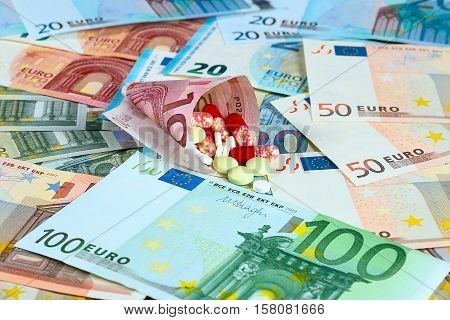 euro paper bills and medical pills and tablets