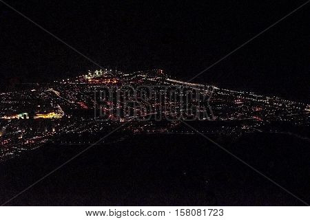 Aerial view from window plane of natal cityscape at night