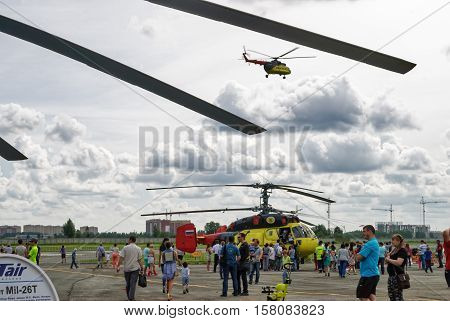 Tyumen, Russia - August 16, 2014: Air show On a visit at UTair in heliport Plehanovo. People explore helicopters