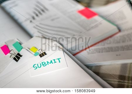 Submit; Stack Of Documents With Large Amount Of Analytic Material.