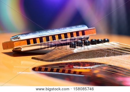 Detail Of Guitar Strings With Supported Harmonica For Country Music