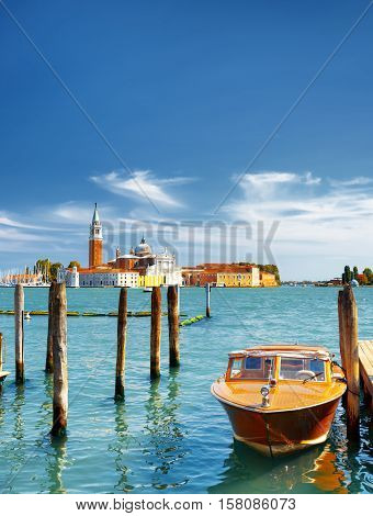 Boat Parked Beside The Riva Degli Schiavoni In Venice, Italy