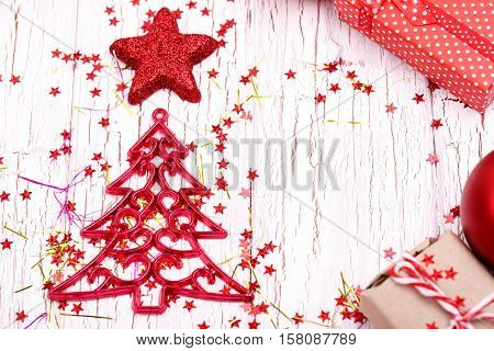 Christmas Toys In Form Of Tree And Star Lie On White Wooden Table