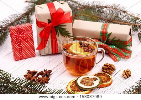 Cup Of Black Tea,gift Boxes And Spruce Twigs Lying On White Floor