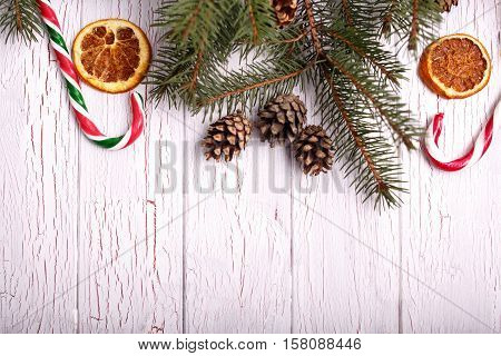 Dried Lemons,cones And Spruce Twigs Lying On White Floor
