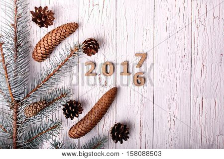 Conifer Cones Lie On White Wooden Table With Wooden Numbers 2017 And 2016