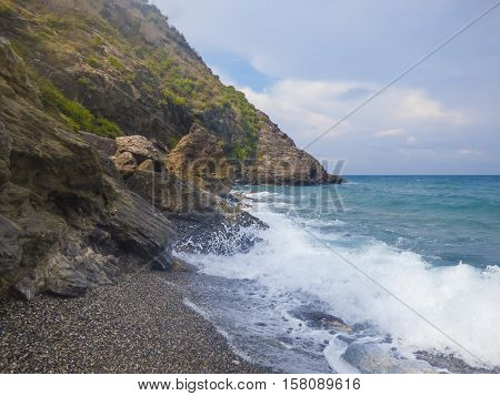 Sunny beach with sea waves at Sicily