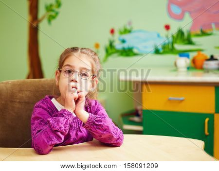 Cute Little Girl In Kindergarten For Kids With Special Need
