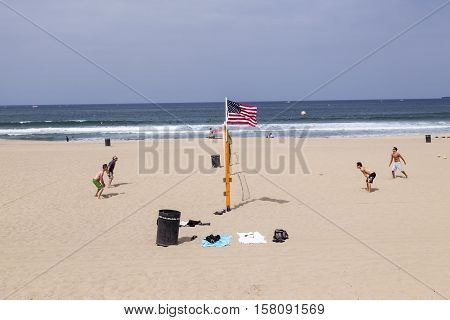 People Enjoy Playing Volleyball At Redondo Beach