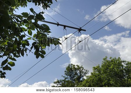 Wires of trolley bus in a sunny day
