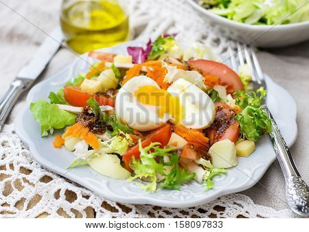 Vegetable salad Parisienne with soft-boiled egg and lettuce