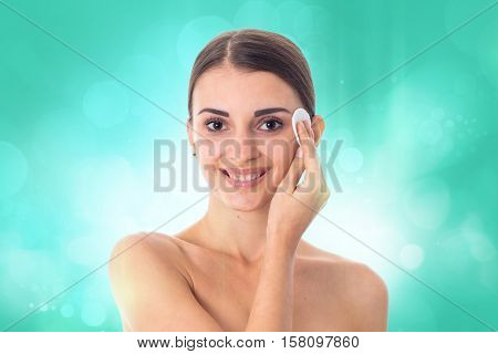 happy Young girl takes care her skin with Cleansing cotton pad isolated on white background. Health care concept. Body care concept. Young woman with healthy skin.