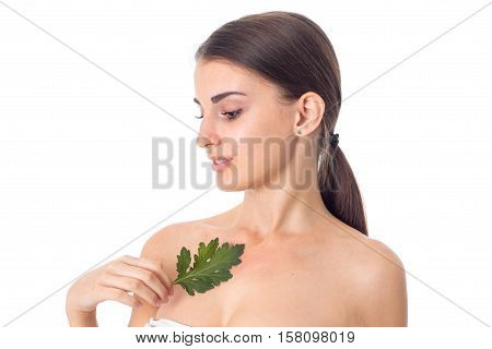 lovely Young girl takes care her skin with green leaf in hands isolated on white background. Health care concept. Body care concept. Young woman with healthy skin.
