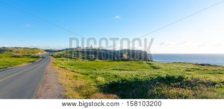 Road to Cape Bona Vista lighthouse station, Newfoundland,  Panoramic vista, bright blue late summer morning over Atlantic Canada.