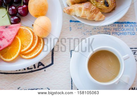 Breakfast including coffee with milk pastries and fruits. Healthy breakfast. Good morning. Breakfast table. Morning breakfast with kruassan. Top view.