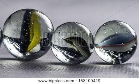 glass marbles studio macro closeup white background