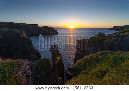 Morning Sunrise over the Atlantic in Lancaster and Cable John Cove, Newfoundland, Canada.