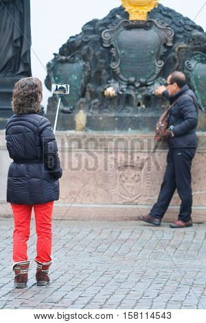 Prague, Czechia - November, 21, 2016: tourists make a photo on Charles Bridge in Prague, Czechia