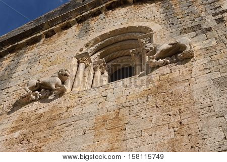 Sculptures on the facade of the Romanesque monastery of Sant Pere Besalu (Century X) Girona province Catalonia Spain