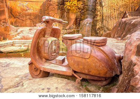 Lam Dong, Vietnam - August 1st, 2016: Big clay sculpture of motorcycle with sidecar in amazing clay town, this architectural only in Lam Dong, Vietnam