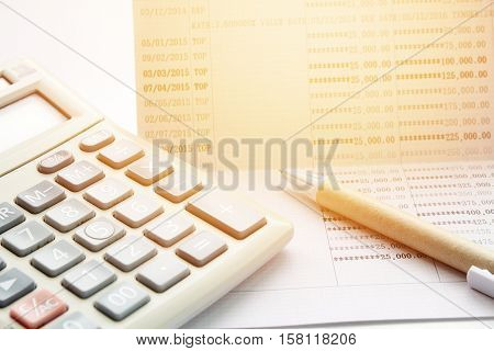 Business, finance savings or mortgage background concept ; Pen, calculator and savings account passbook on white background