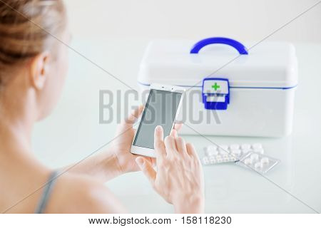 Woman Using Smartphone For Buying Drugs In Online Pharmacy