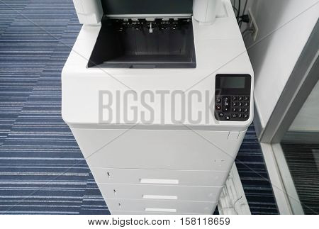 close up blank printer output tray in office