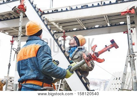 worker installing falsework construction