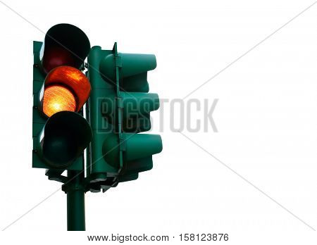 Green traffic light with burning yellow lamp supervisory road. Transport street routes management object for city crossroads. Isolated on white background