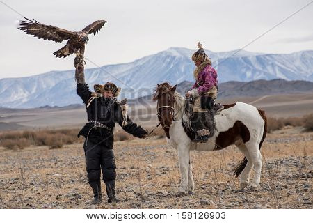 Kazakh Eagle Hunters In Traditionally Wearing Typical Mongolian Dress Culture Of Mongolia.she Rider