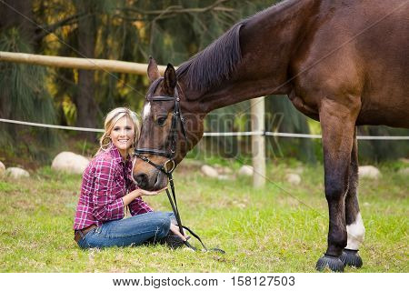 Beautiful Elegance Back Woman Cowgirl, Riding A Horse Wearing Blue Jeans, Boots. Has Slim Sport Body