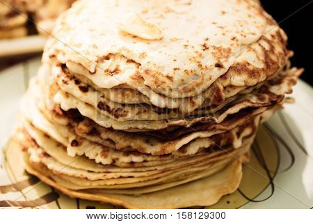 A stack of pancakes - traditional folk meal of the eastern Slavs. Maslenitsa