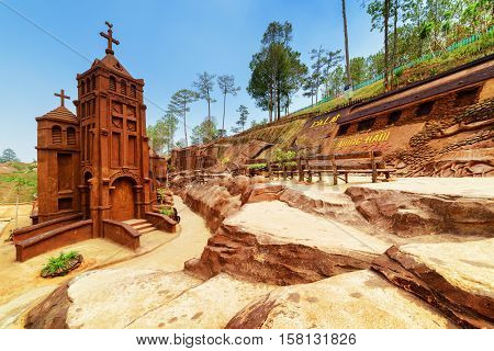Clay Building Of Church On Blue Sky Background