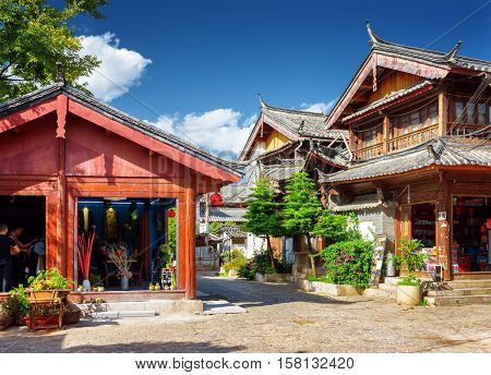 Wooden Traditional Chinese Houses In The Old Town Of Lijiang