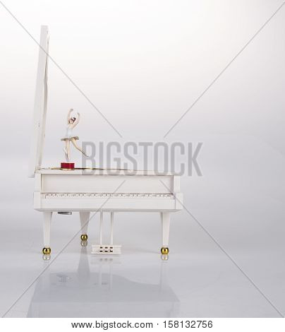Toy Music Box Or Piano Music Box On A Background.