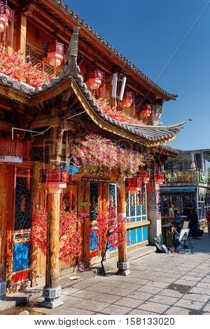Facade Of Traditional Chinese House Decorated With Flowers, Dali