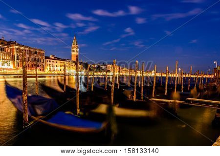 Gondolas or boats on Grand canal at night in beautiful city Venice