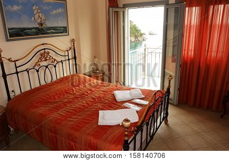 Parga GREECE May 09 2013: Stylish interior of bedroom with view on the bay in a small town on the coast of the Ionian Sea in Greece.