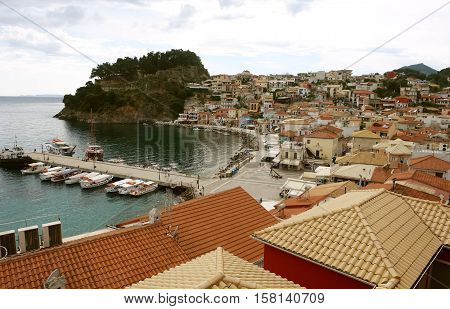 Parga GREECE May 09 2013: View on the Greek coast with boats in bay of Parga town on the coast of Ionian Sea.