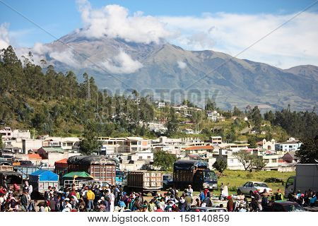 February 26 2011, Otavalo Ecuador. Local families meet for shopping, selling, trading and socializing in Otavalo Ecuador at the live market in the Andes mountains.