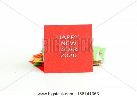 picture of a red note paper with text happy new year 2020