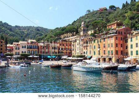 Portofino Port With Colorful Houses, Boats And Mediterranean Sea, Italy