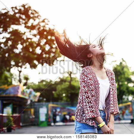 Young Girl Hair Fling Funfair Festive Playful Happiness