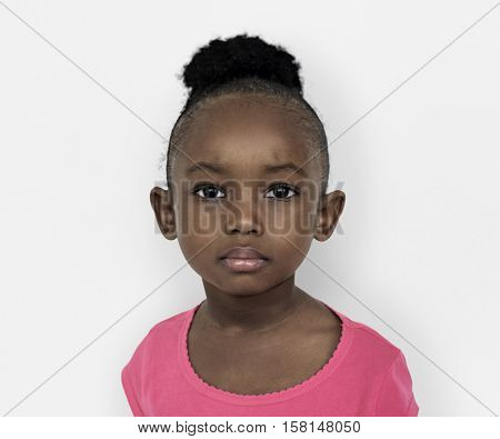 Black little girl serious facial expression portrait