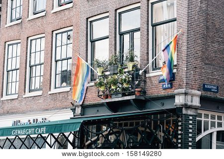 Amsterdam Netherlands - August 1 2016: Gay pride flags in a building in Amsterdam in Red Light District
