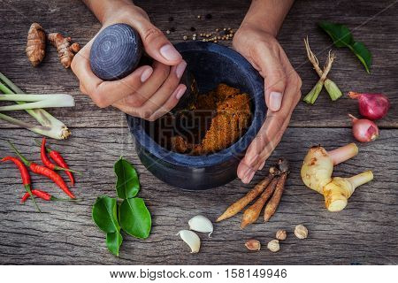 The Women Hold Pestle With Mortar And Spice Paste . Red Paste Ingredients For Red Curry On Rustic Wo