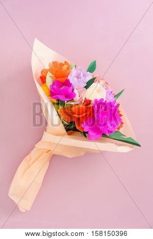 Bouquet of handmade paper flowers in tissue paper