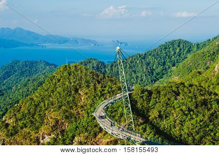Photo of the Amazing aerial landscape with Sky bridge symbol Langkawi Malaysia. Adventure holiday. Modern technology. Tourist attraction. Travel concept. Andaman sea backgroun