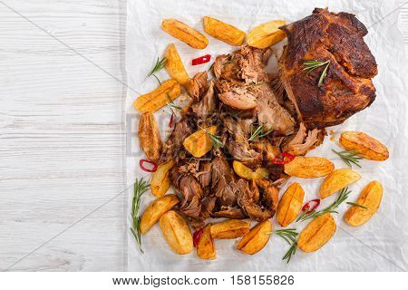 Pulled Slow-cooked Pork Grilled In Oven With Fried Potato