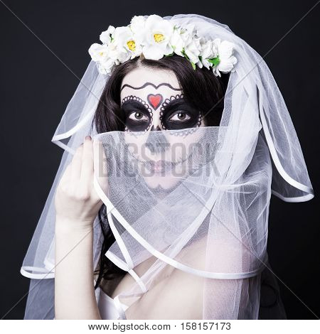 Beautiful Woman Bride With Creative Sugar Skull Make Up And Bridal Veil Over Black